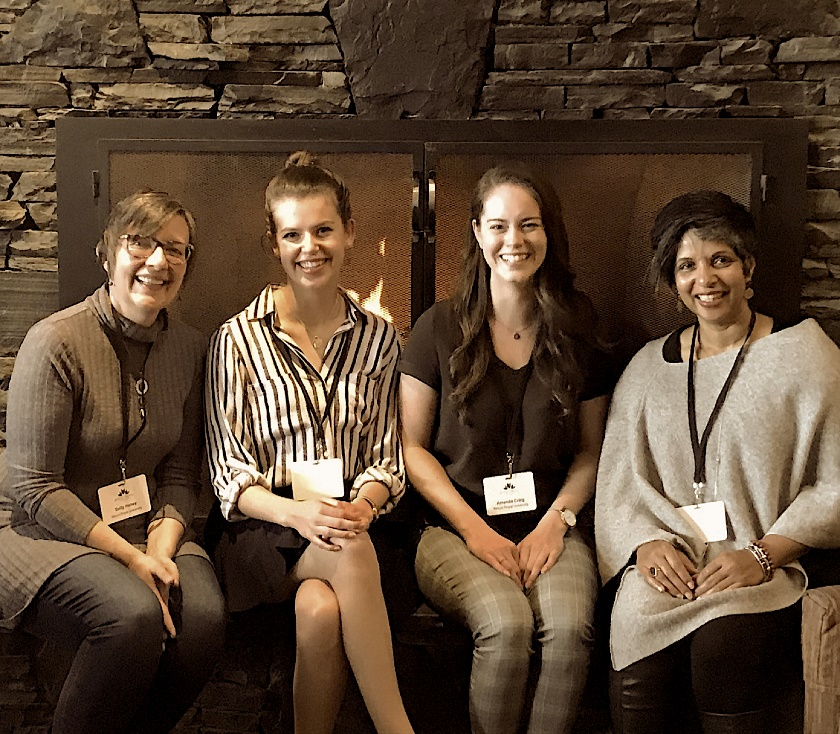 A photo shows the authors sitting in front of a fireplace.